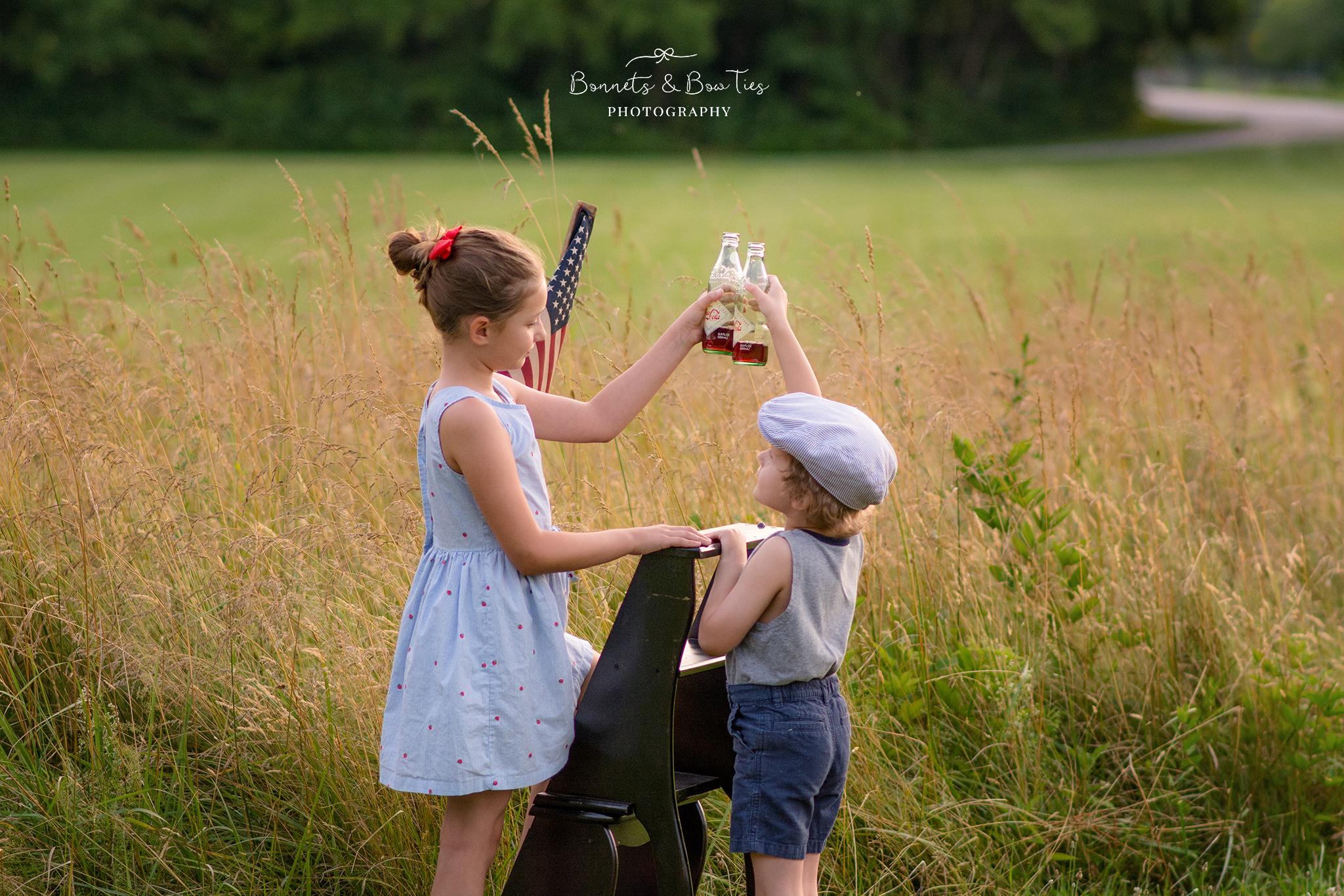 two kids share a coke.jpg