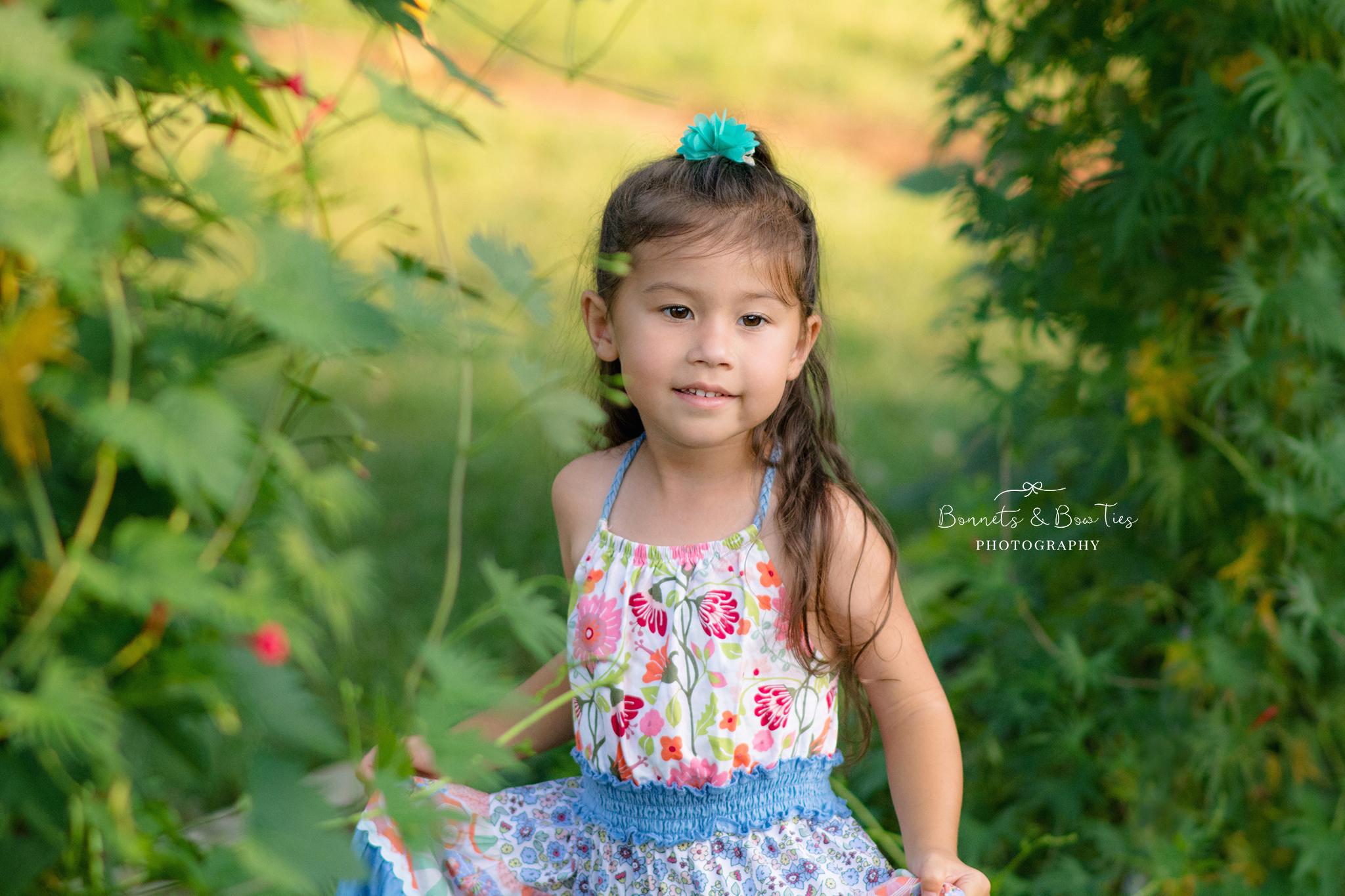 little girl wearing floral dress.jpg