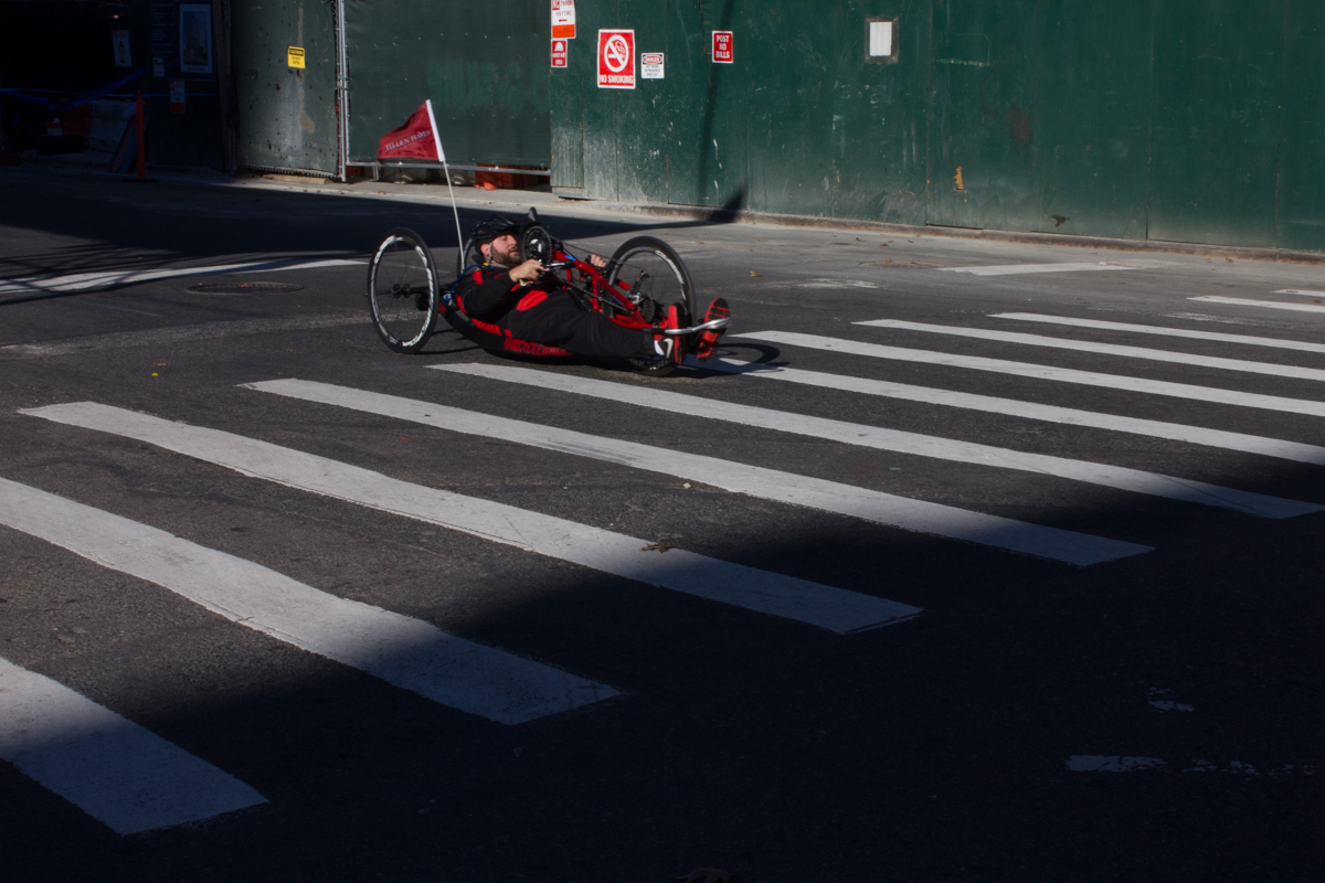A handcyclist participating in the New York City Marathon speeds down Lafayette St. in Brooklyn.