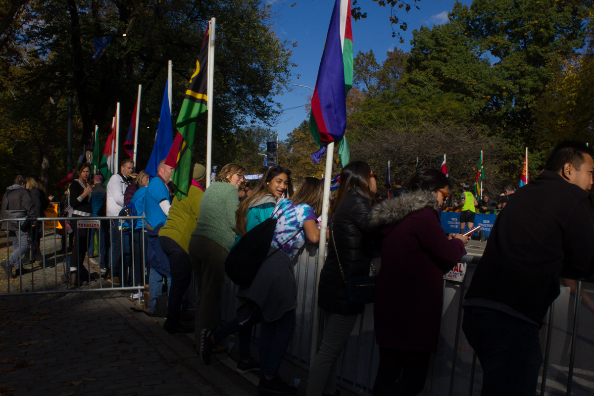 Spectators watch runners approach the end of the marathon in Central Park.