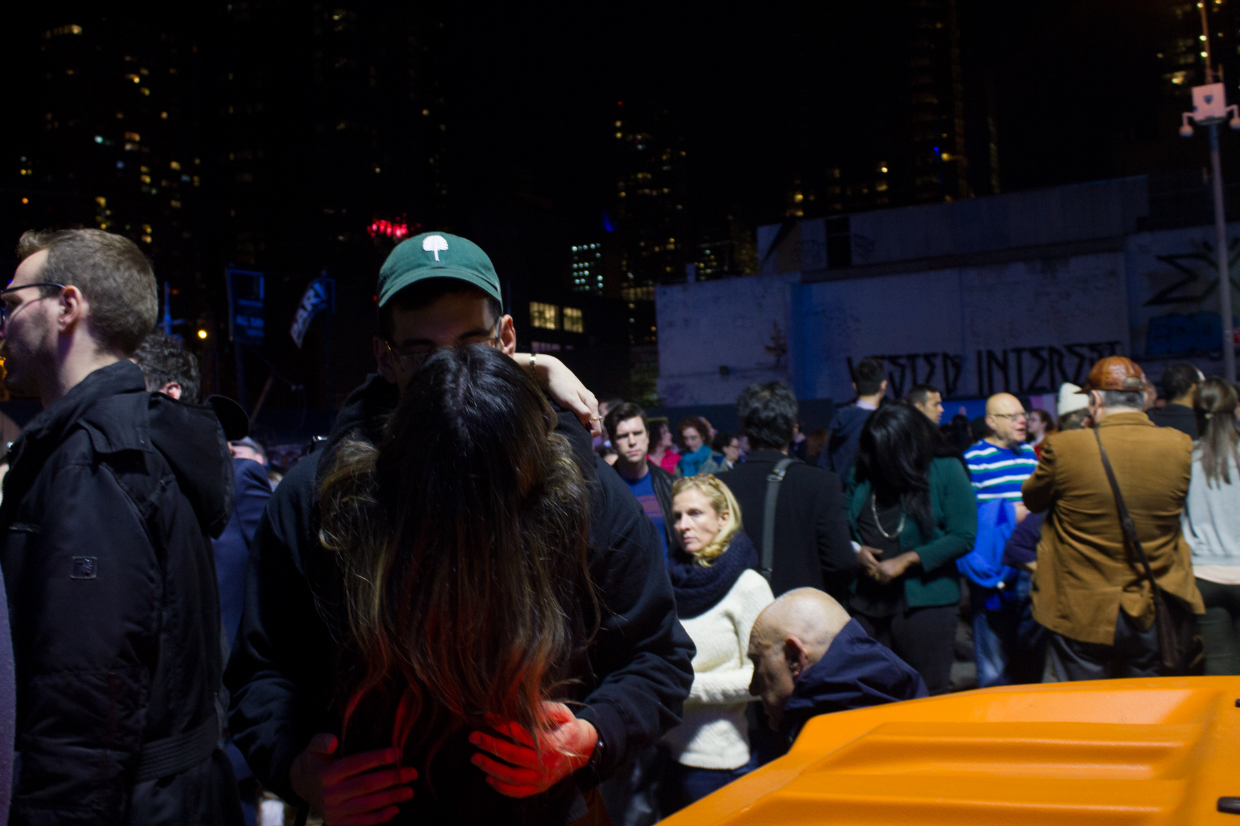 A couple kiss upon finding one another outside of the Javits Center.
