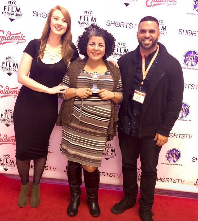 McKenna Cox, Rachel Strauss-Muniz and Mike Diaz receiving the awards for Best Ensemble, Best Cinematography, and Best Production Design for  Latino Vortex  at the NYC Indie Film Festival.