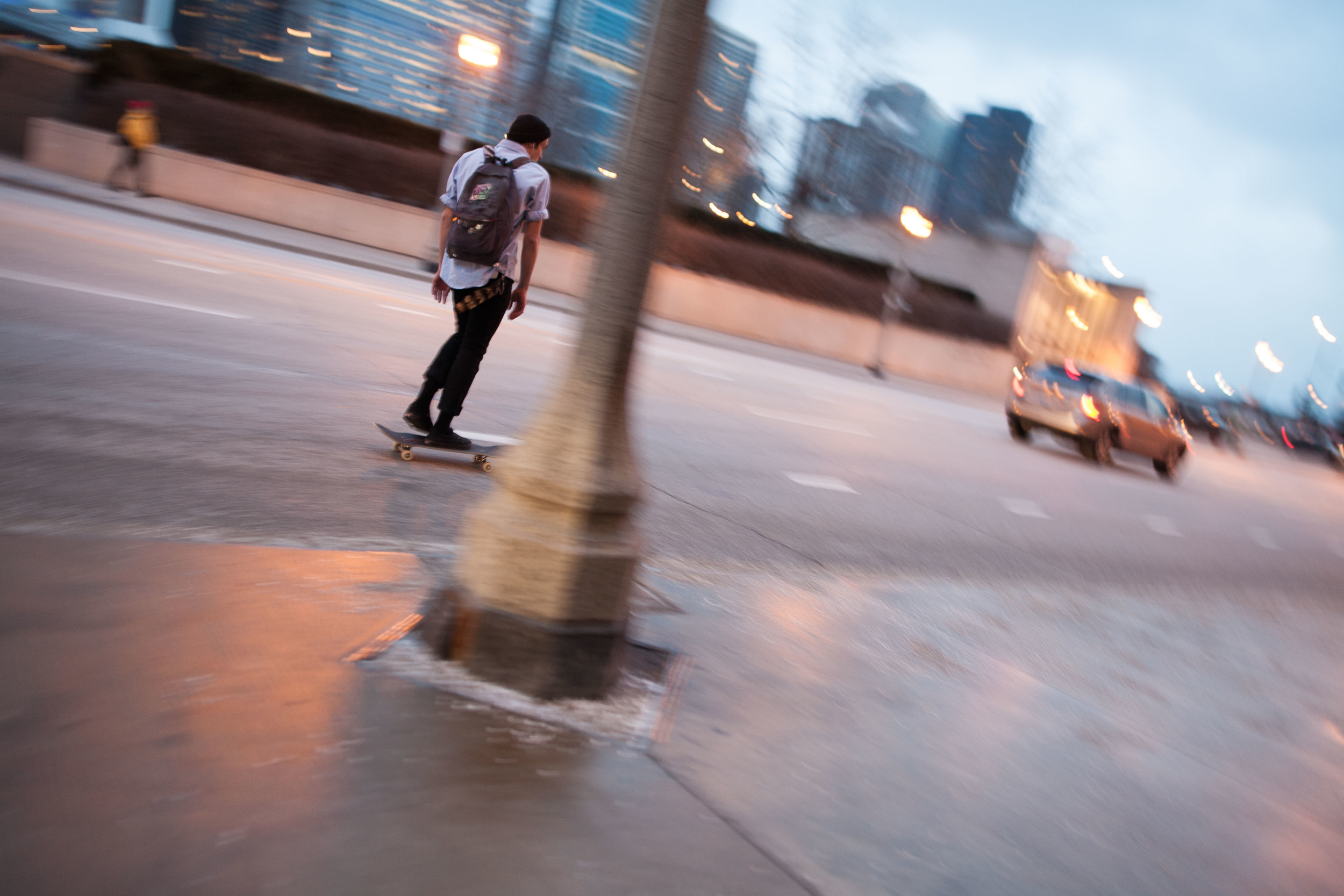 A skateboarder in Chicago cruises down East Monroe Street on a cold, damp January evening.