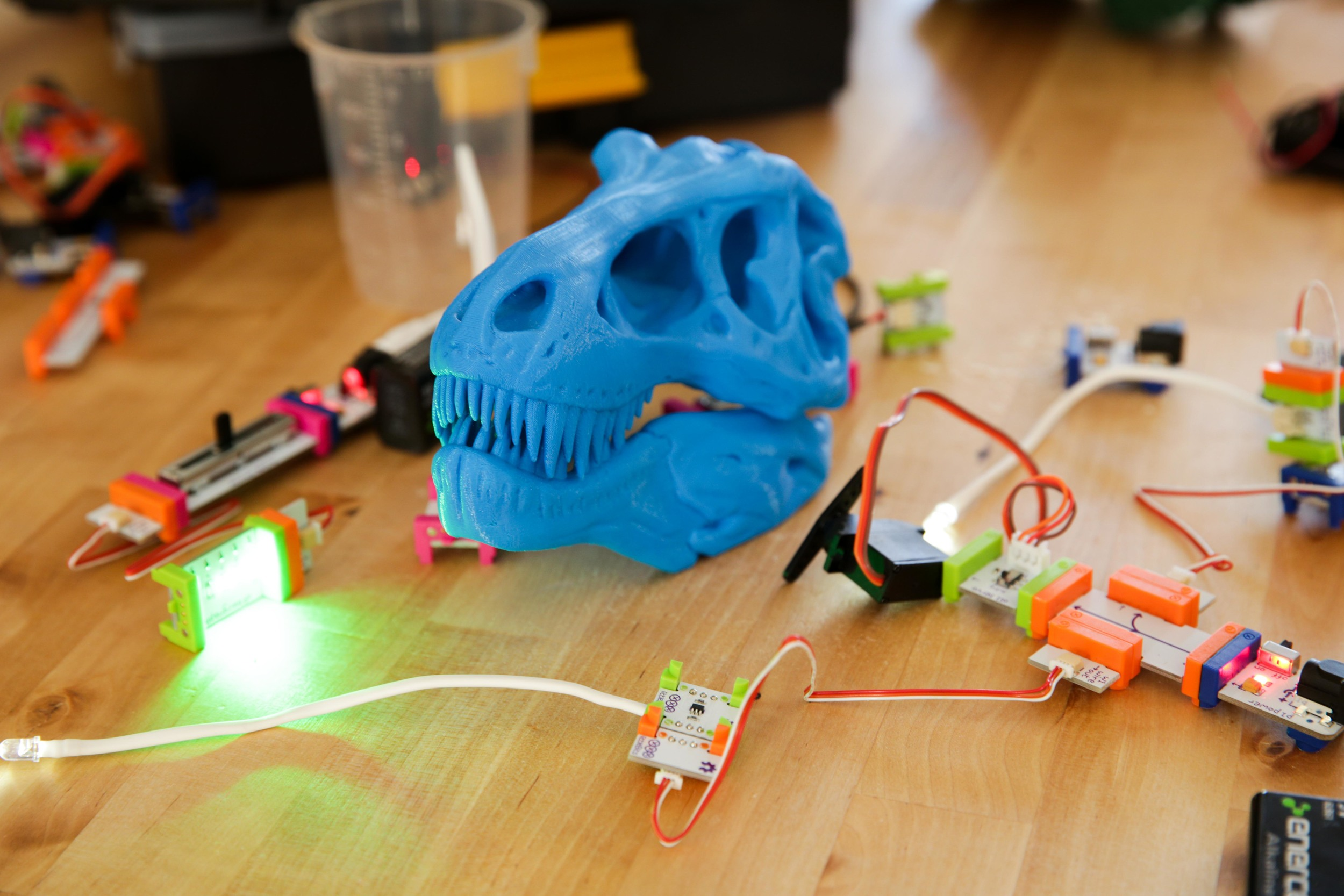 Kid friendly electronics and a 3D printed T-rex skull, photographed for the Laboratory Chicago