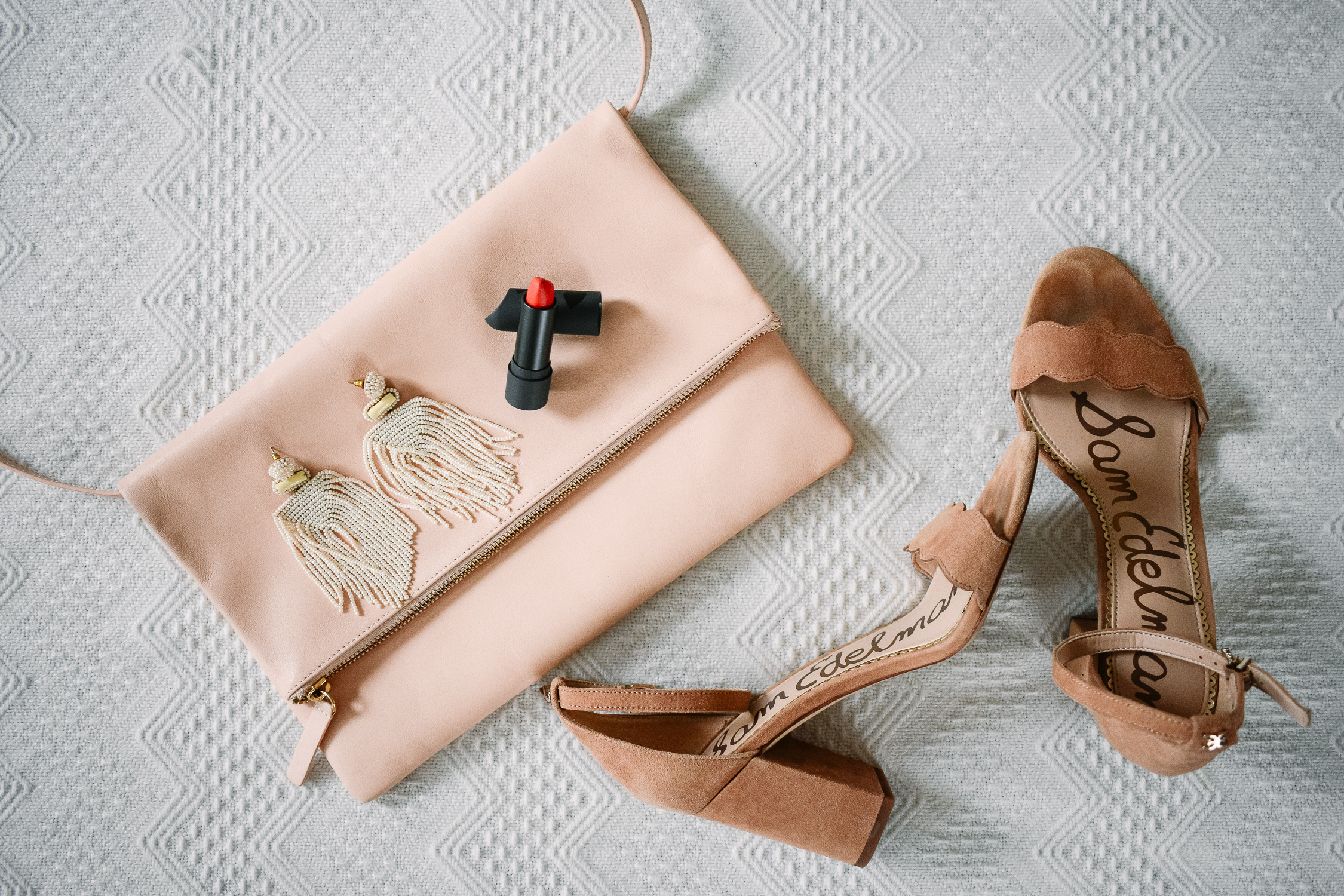 Statement earrings, bold lipstick, nude purse + sandals