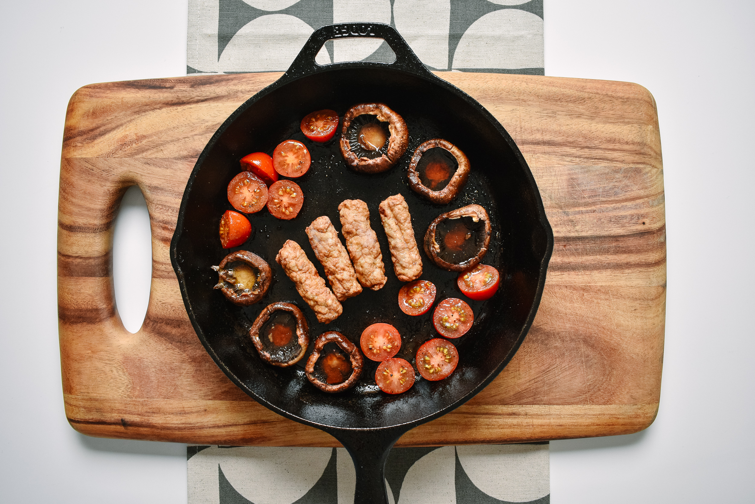 Add the sausage to the middle of the pan