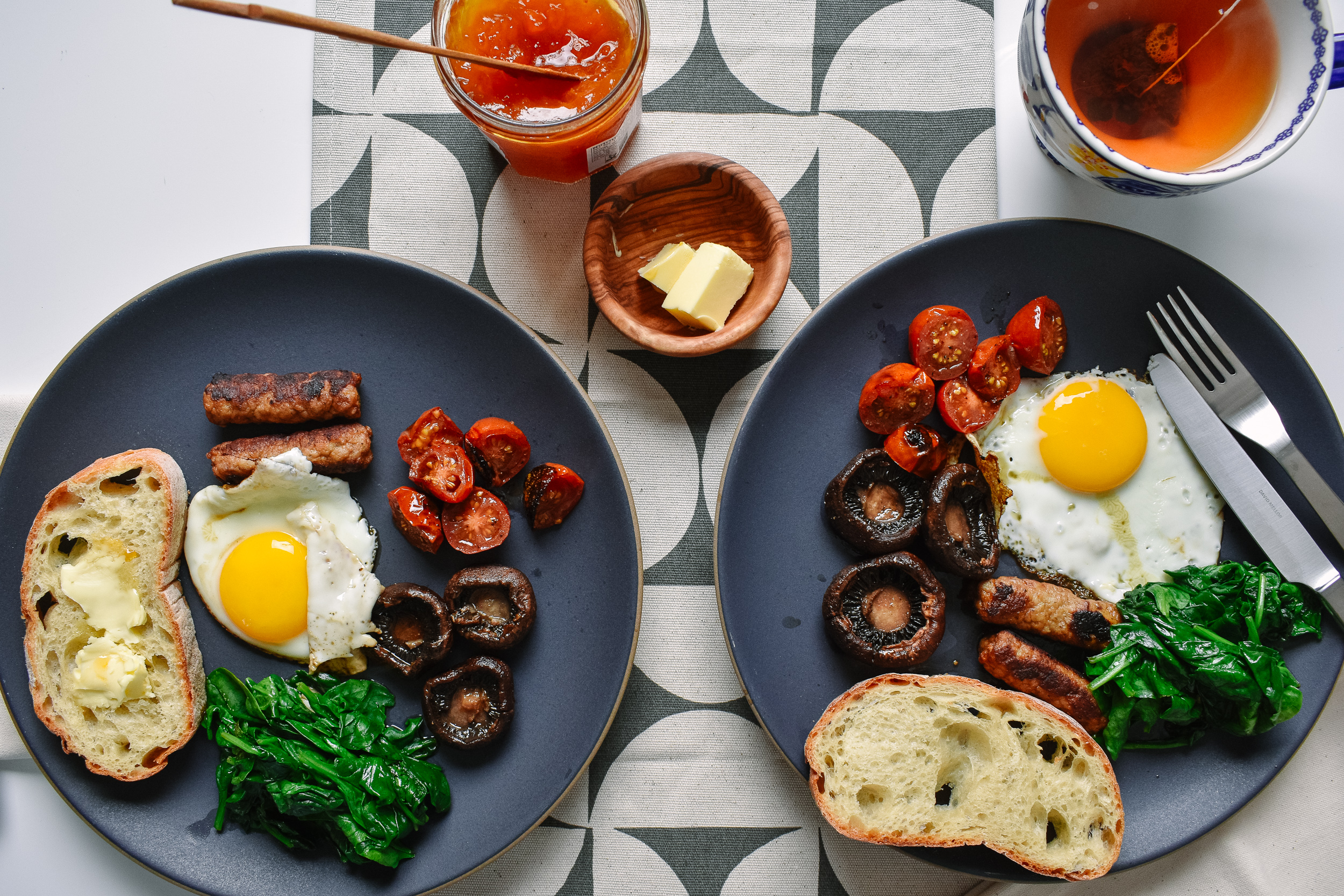 Start the toast, plate the fried eggs, then sauté the spinach