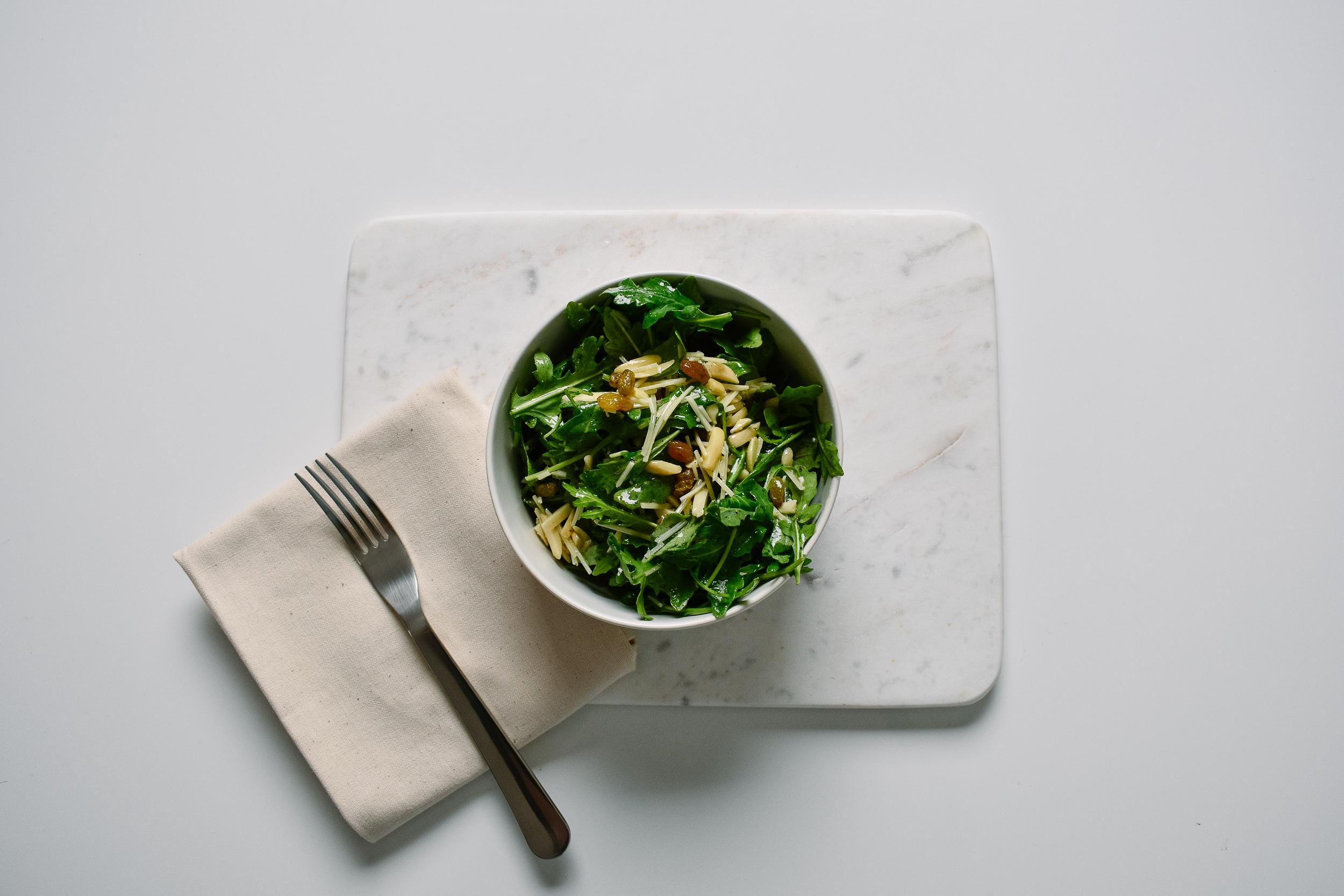 Arugula, parmesan, almond, golden raisin salad