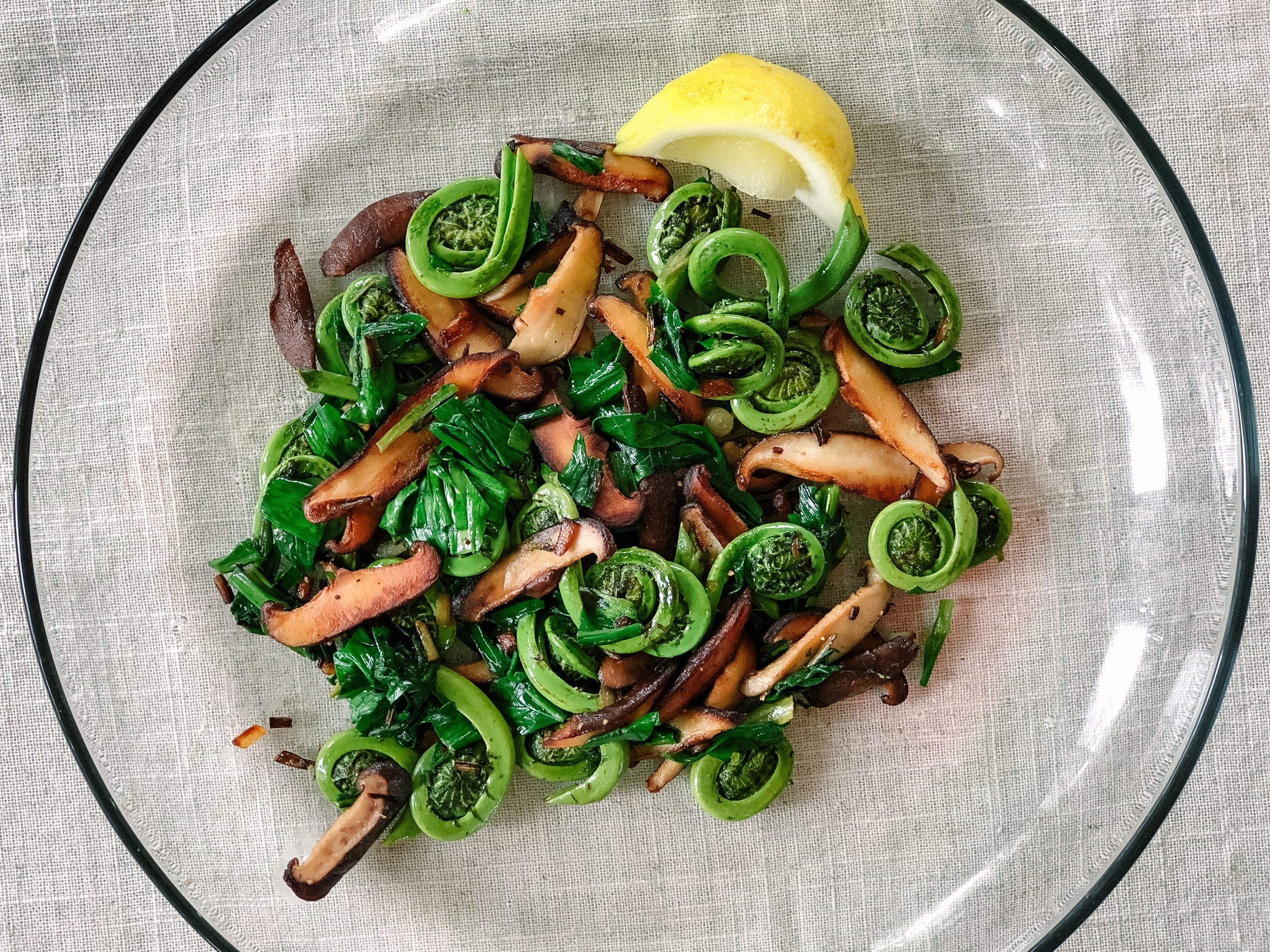 Forages fiddleheads and ramps with shiitake mushrooms