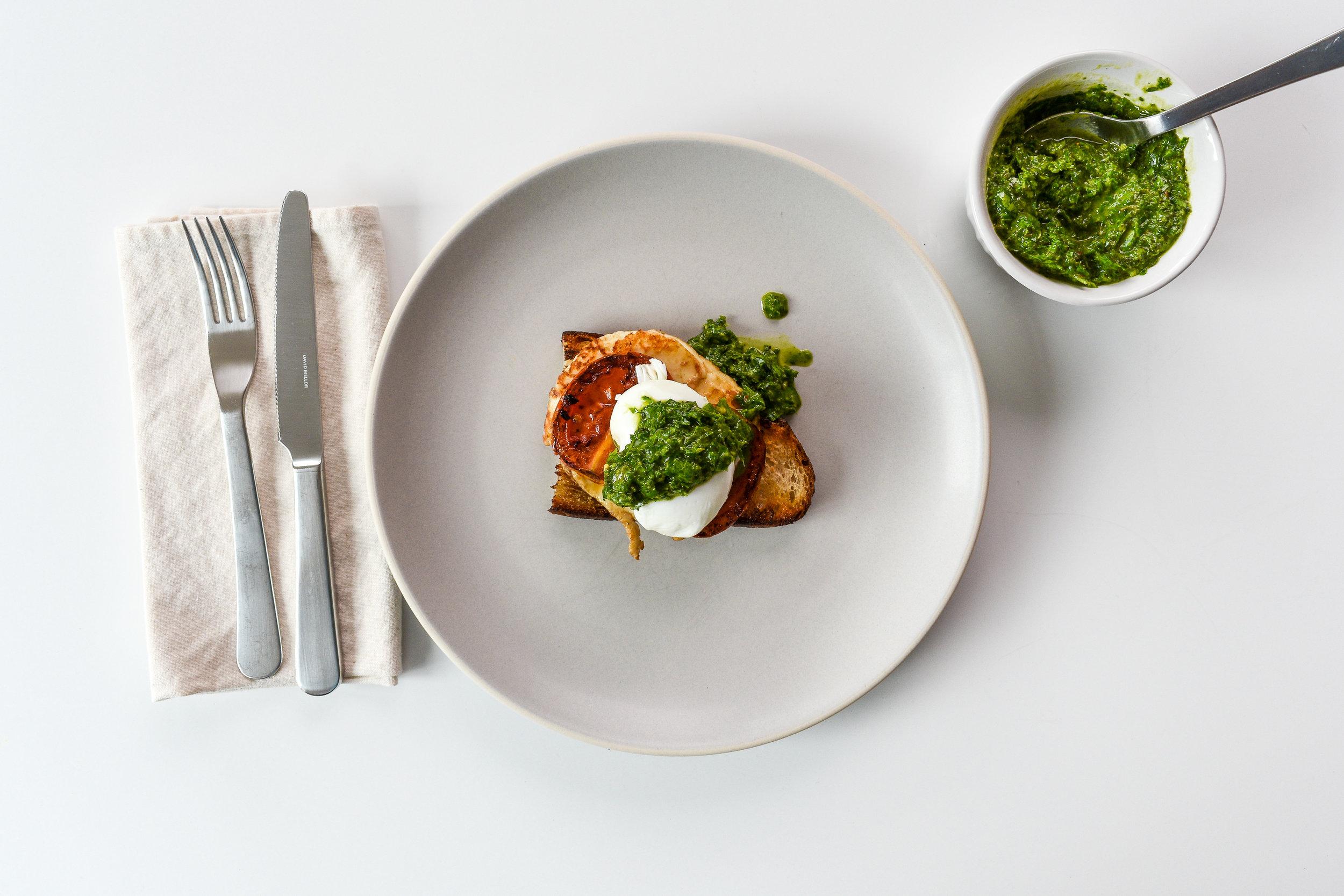 Eggs Benedict with Halloumi, Tomatoes, and Chimichurri