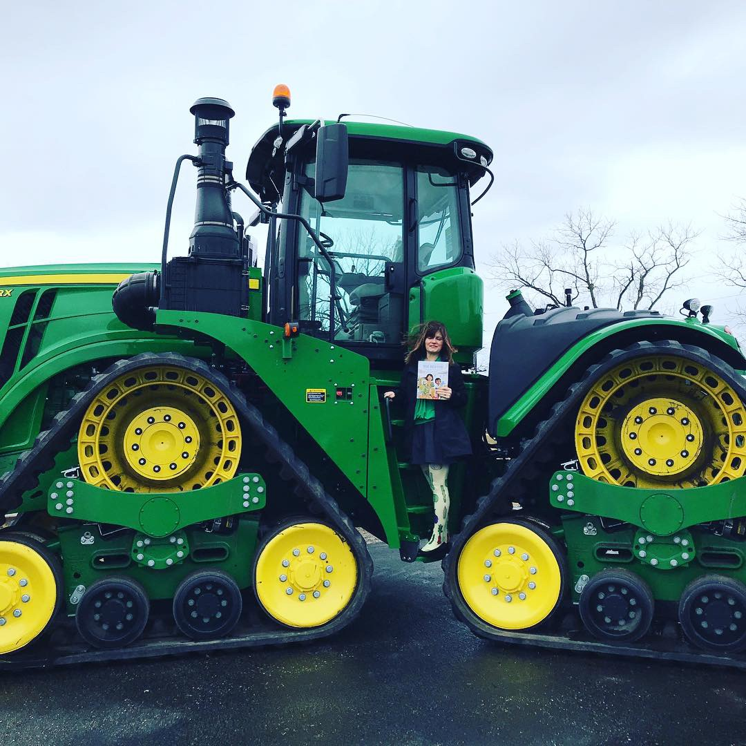 Click on Image to watch a video of Michelle Schaub sharing fresh-picked poetry from the cab of this giant John Deere Tractor.