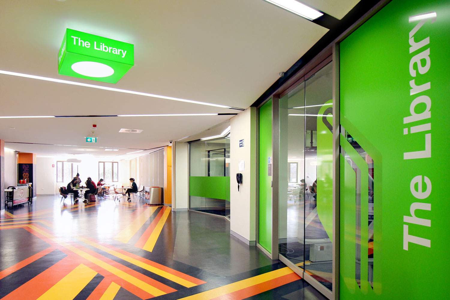 CSU, Wagga: We designed and made bespoke light fittings mounted on the ceiling to identify key areas in a crowded space.