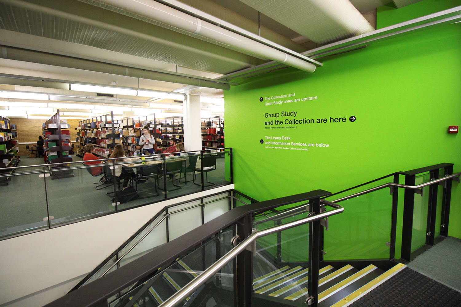 CSU, Wagga: Cost effective directional signage - we painted the main staircase wall to add some colour to the oder part of the library and applied large directional vinyl signage
