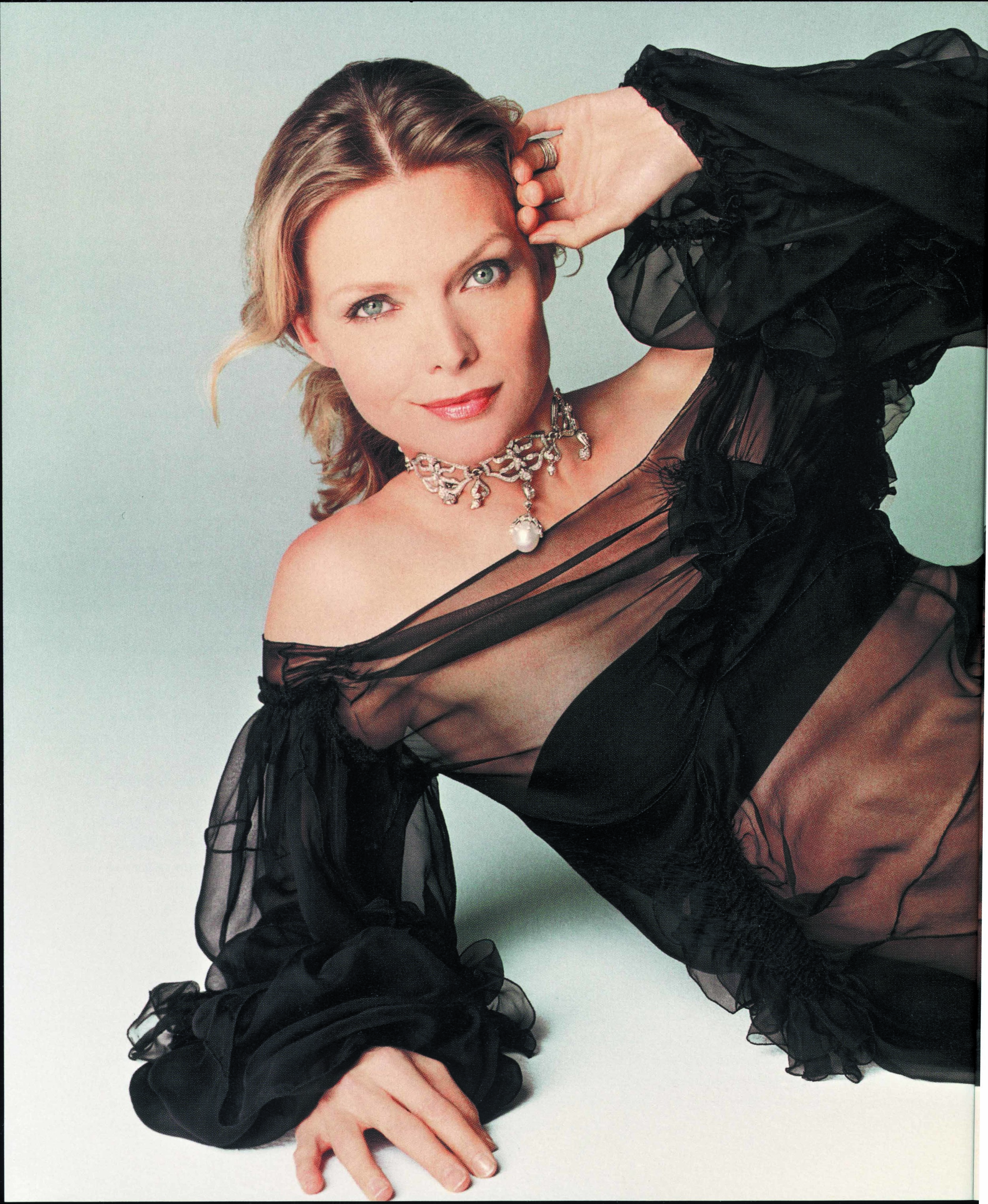 Michelle Pfeiffer modeling some of our 18K Couture Collections in this InStyle Magazine spread.