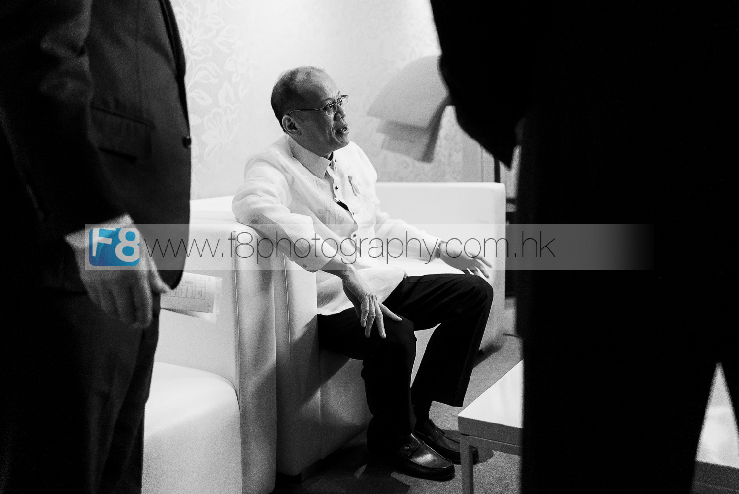 President Benigno S. Aquino III of the Philippines, backstage being briefed and surrounded by his bodyguards just before he officially opened the APEC 2015 Summit.