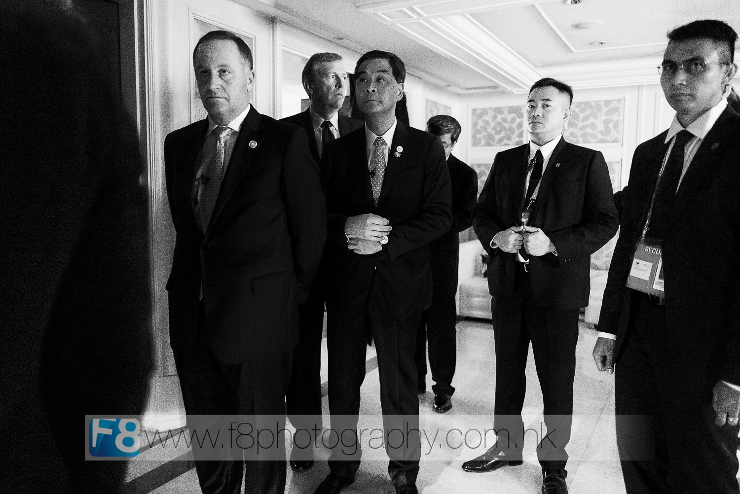 Prime Minister Of New Zealand mr john key (fronT left) and chief executive of hong kong mr CY LEUNG preparing to go on stage.  their two bodyguards keeping an eye on me whilst i work in the shadows...