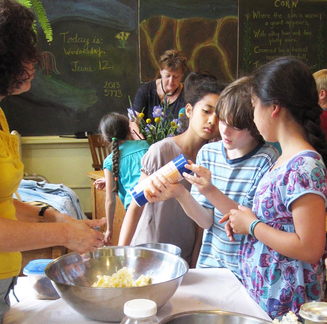 Third graders making arepas during Spanish class.