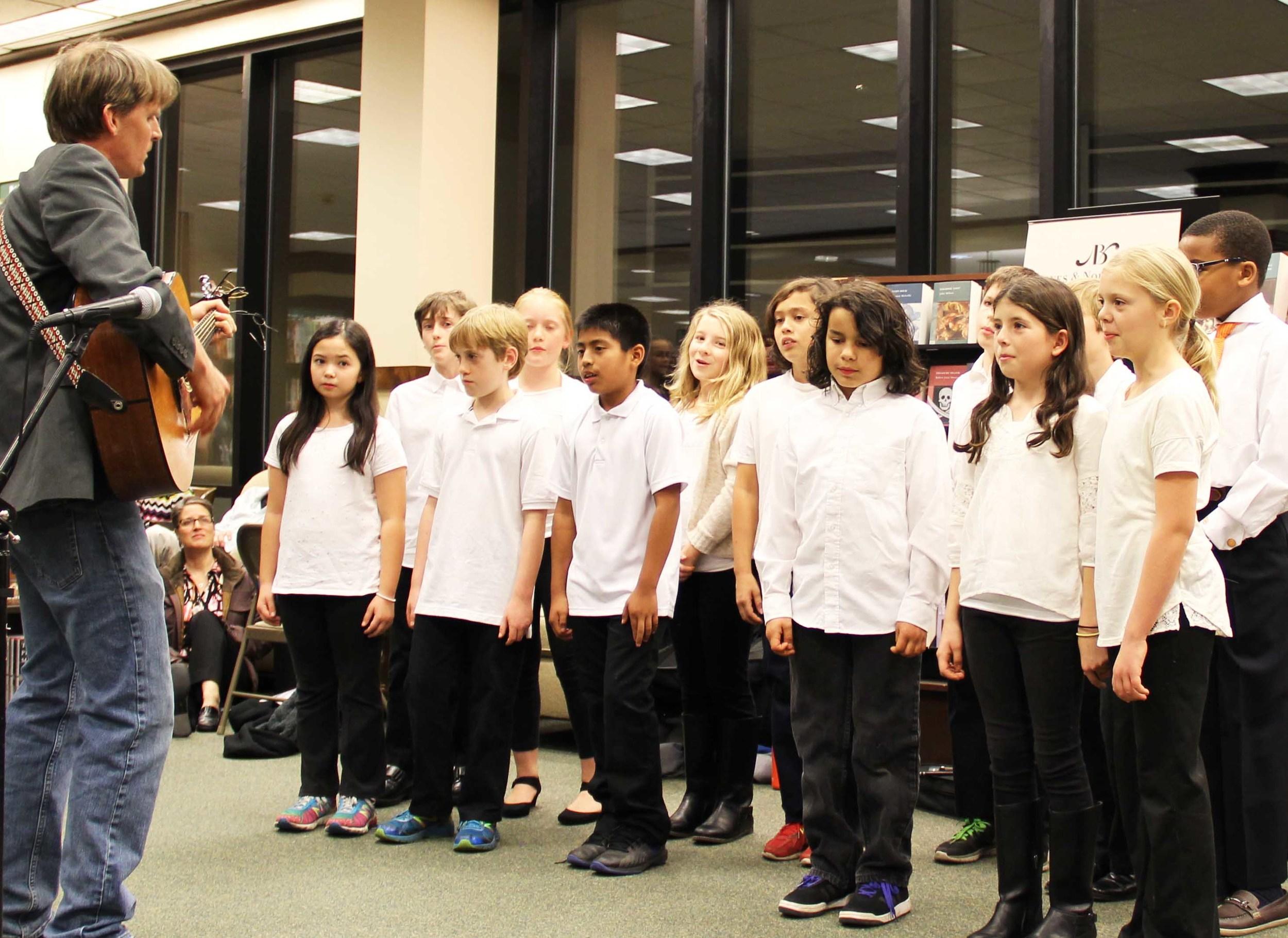 Grade 5 chorus performs at a Barnes & Noble book fair.