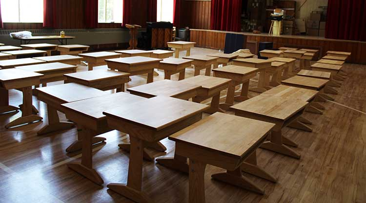All the hand-crafted wooden desks were refinished so students have beautiful work surfaces.