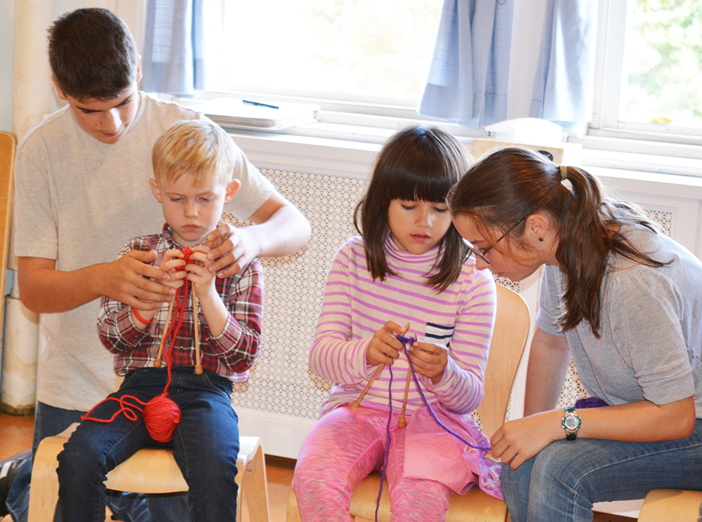 At WSL, 8th graders help their 1st grade buddies learn to knit. Students continue handwork from grades 1–8, learning skills of increasing difficulty.