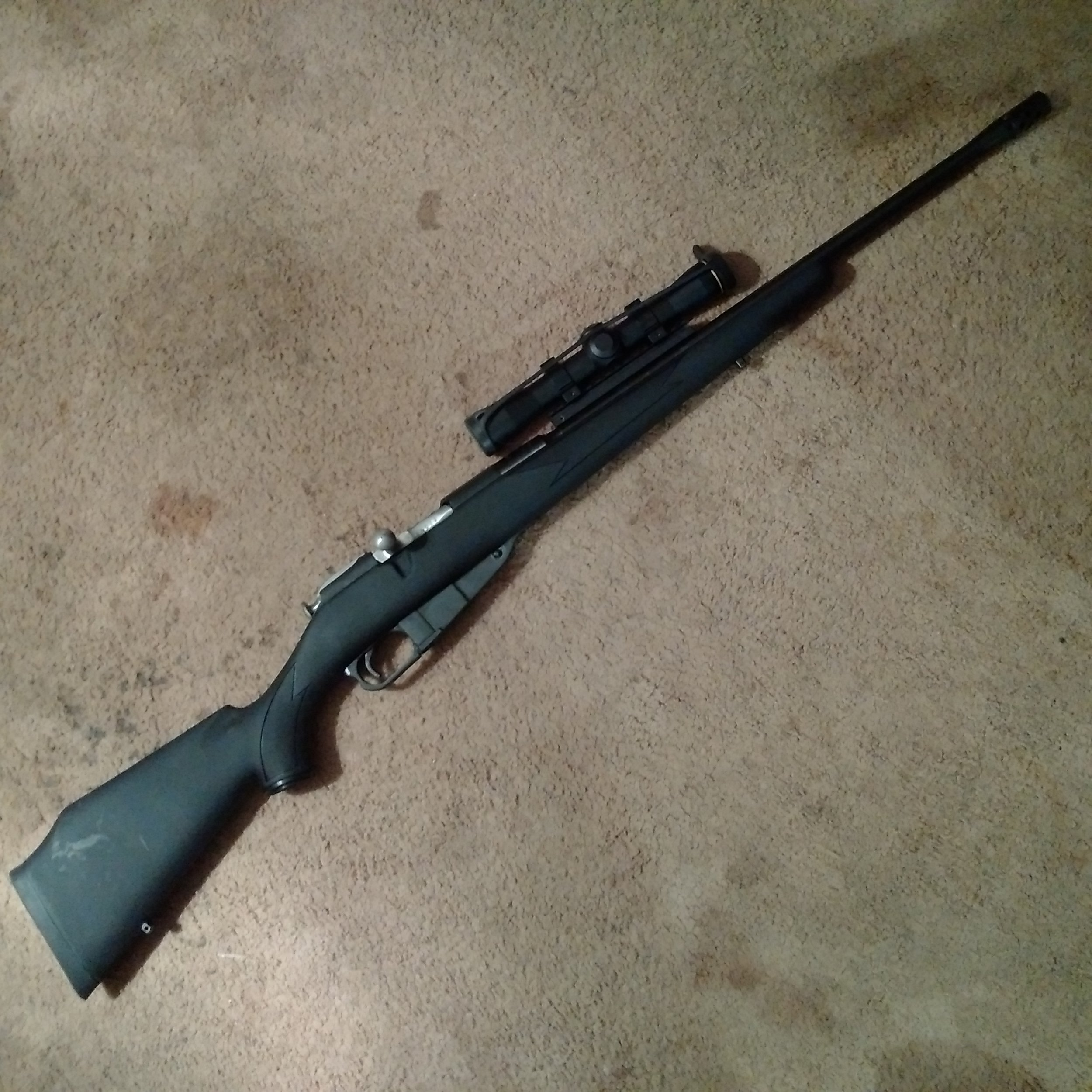 Customized Russian Nagant, custom scout mount for scope, synthetic stock, muzzle break, trigger job, recoil reducers.