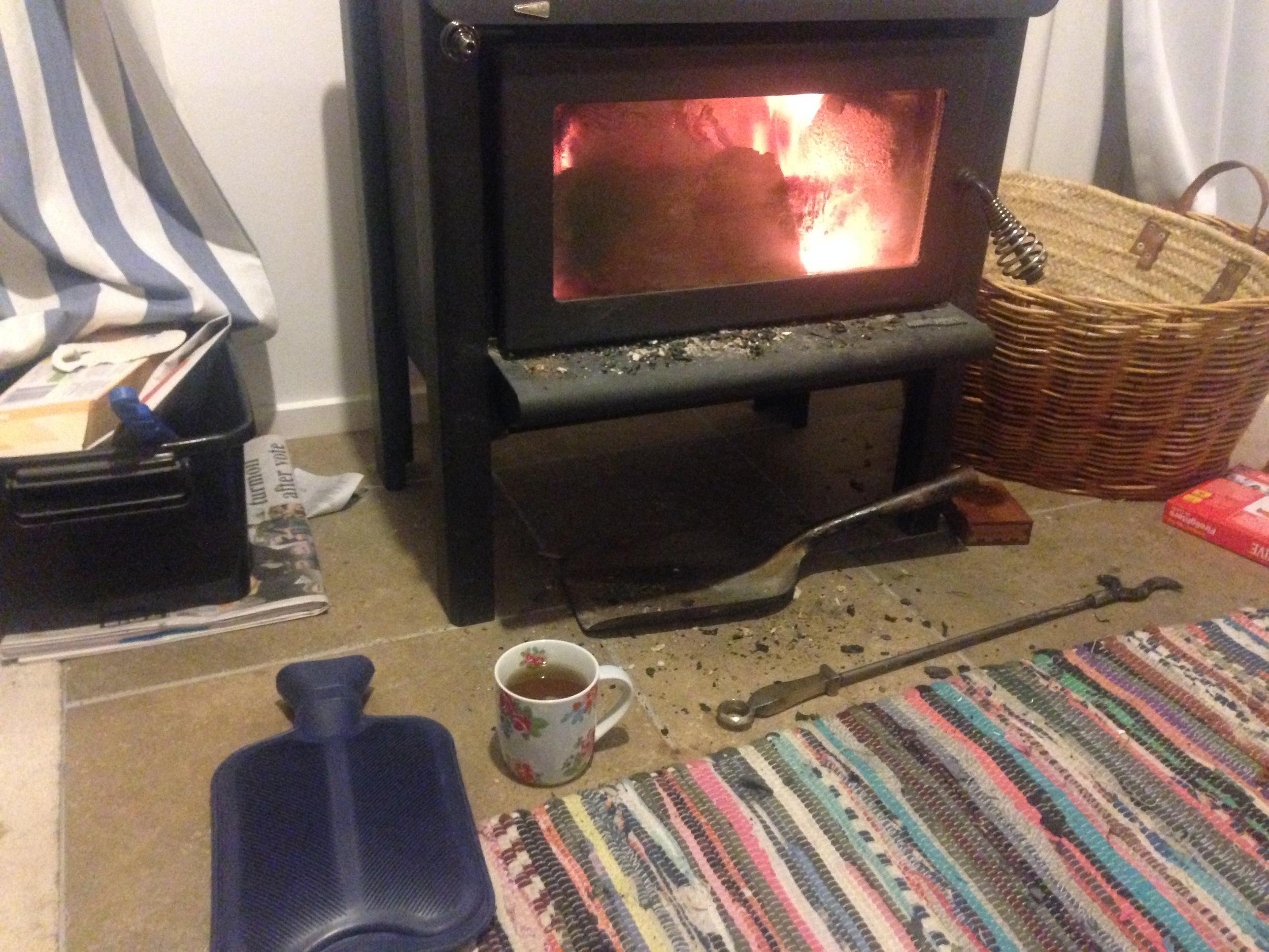 New Zealand winter starter kit: Hot water bottle, cup of tea, wood burning stove.