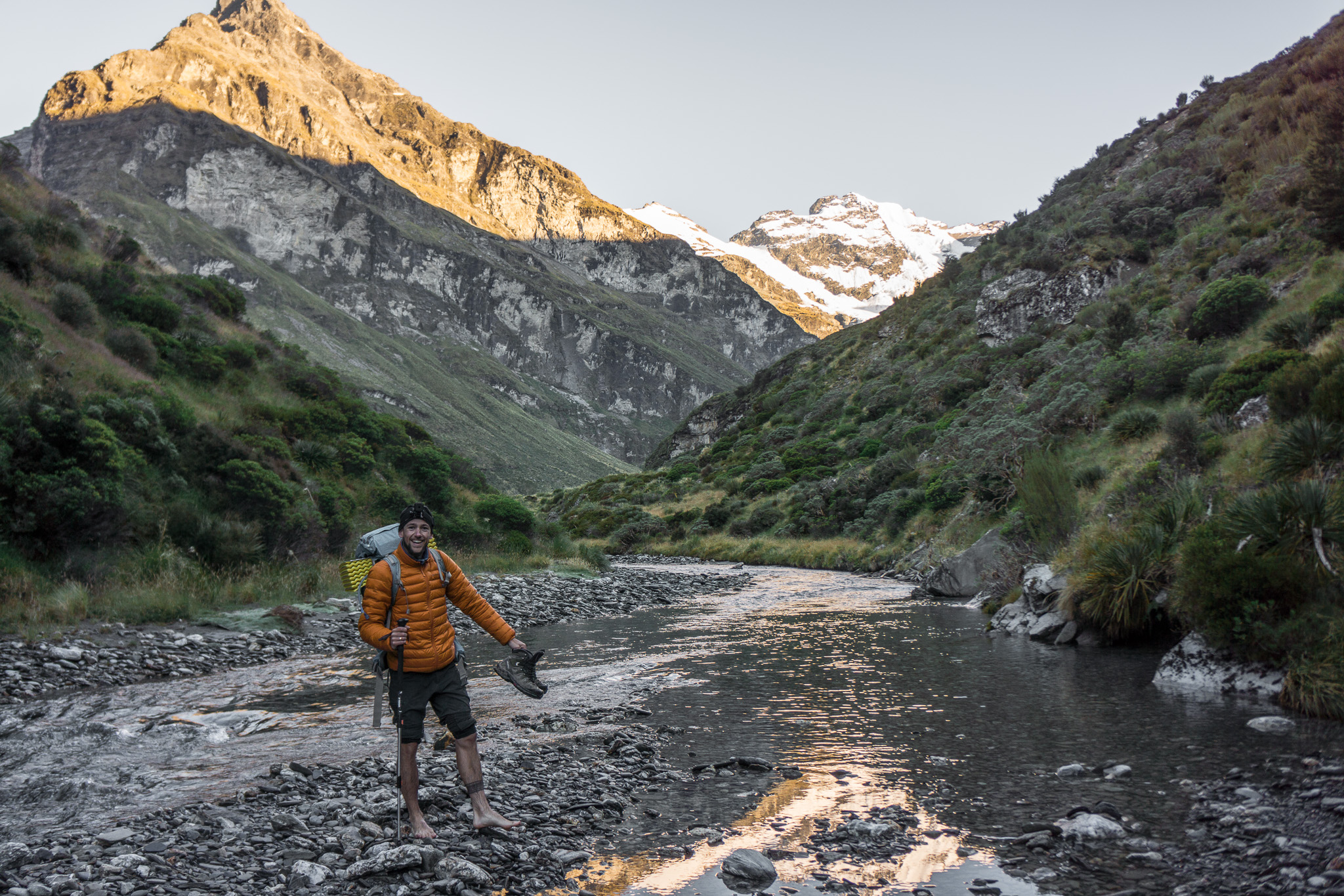 Tanguy fording the river to the rock bivvy