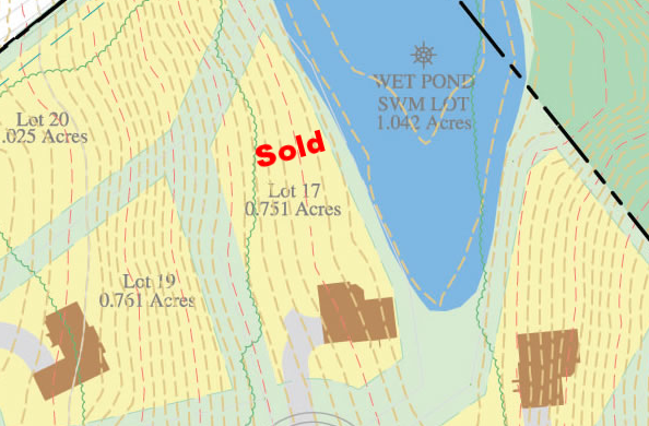 Lot #17 borders the 1 acre pond. The running fountain will complement the bird calls from the woodlands across the water.