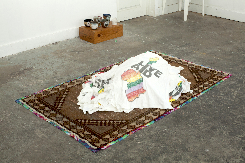 Matt Siegle Loop, 2011, sharpie and spray paint on thrifted charity shirts, carpet, tie-dye fabric