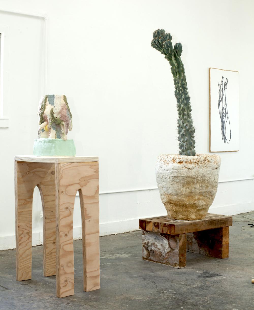 (Left to Right) Alice Lang, Better Half 2, 2017,  Lava glaze on ceramic w/ plywood base   |   John Zappas, Big John Pot, 2017, Hydracal and redwood base