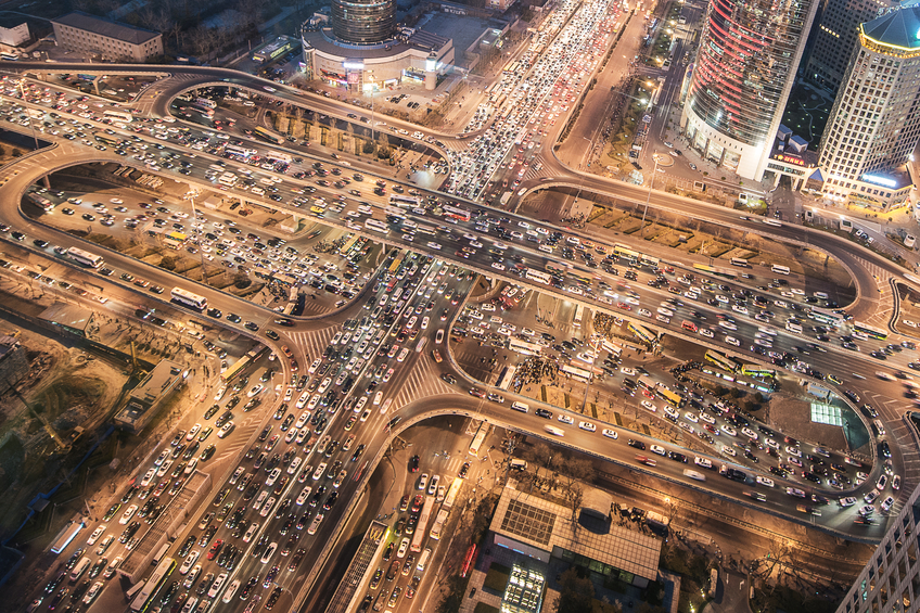 An aerial view of heavy traffic on city roads