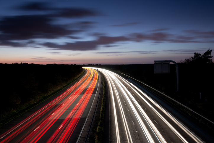 View of red and white car lights on UK motorway at night