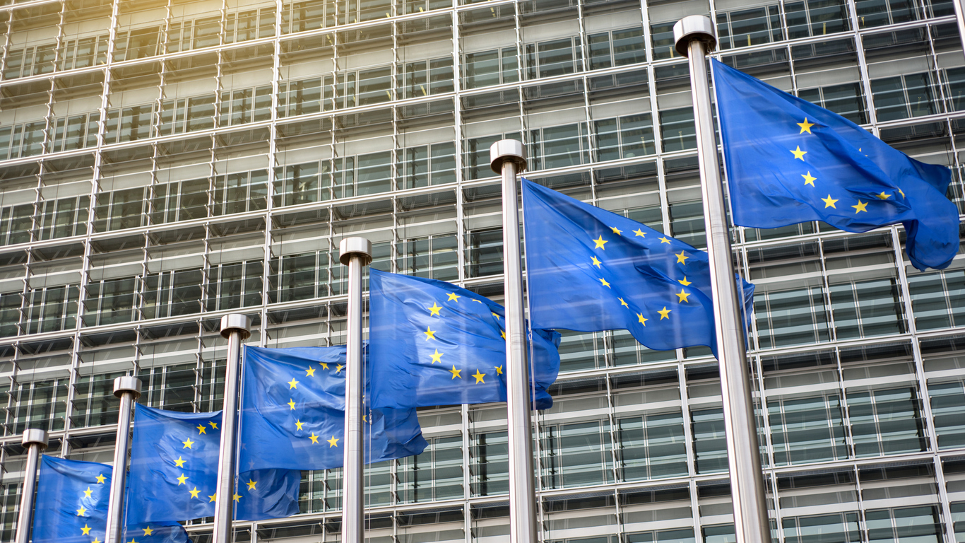 European union flags in front of building