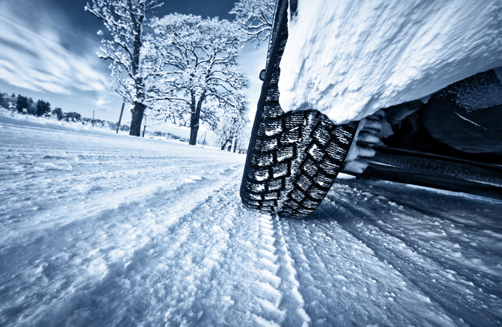 Car tyres on winter road