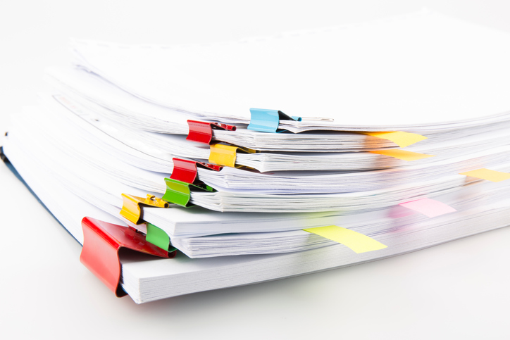Pile-of-documents-with-colourful-clips.jpg