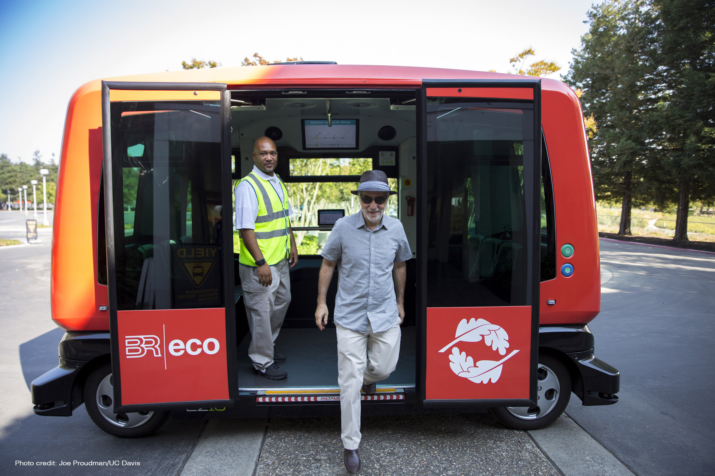 Sperling exiting an automated electric shuttle bus at Bishop Ranch business park in San Ramon, California. The shuttle is part of a pilot program intended to eventually ferry employees along designated routes in the business park. (image credit: Joe Proudman/UC DAVIS)
