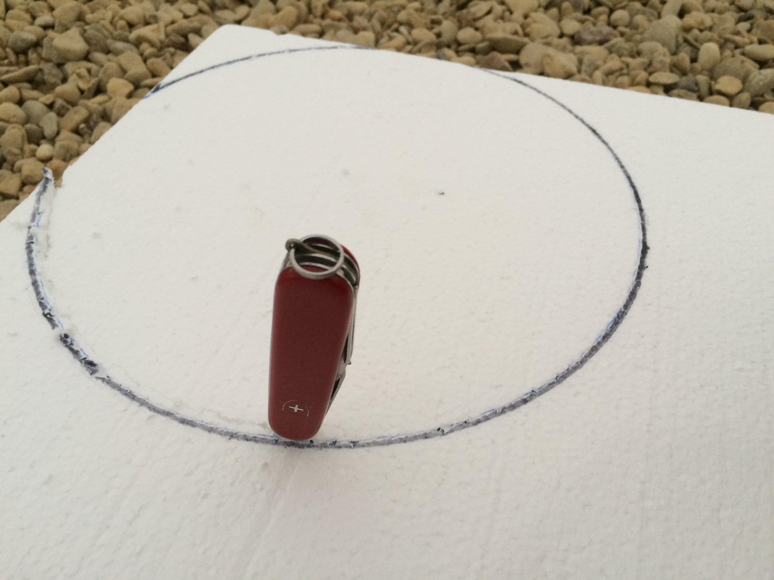 Cut foam board to fit inside a 5 gallon bucket.