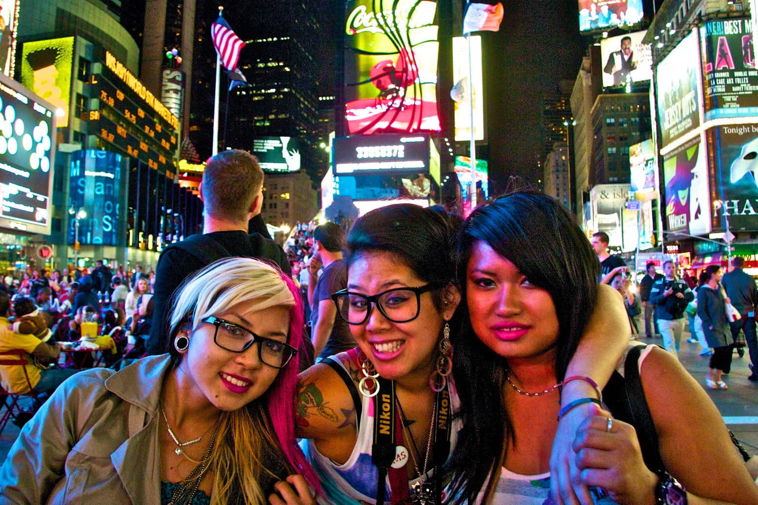 Times Square cross-culture friendship. New York, USA.