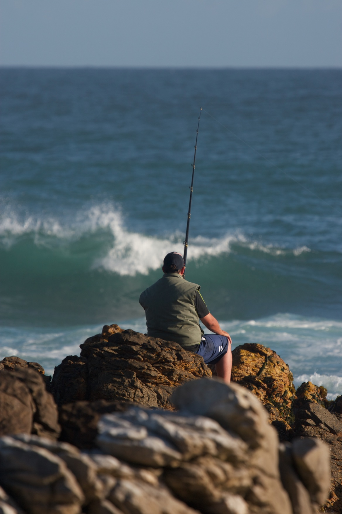 Fishing where the Indian Ocean meets the Atlantic. Agulhas, South Africa.