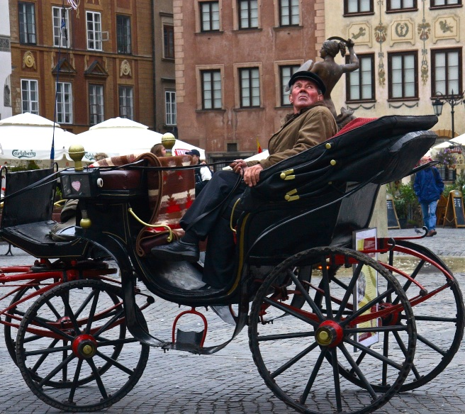 Chauffeuring the old-fashioned way. Warsaw, Poland.