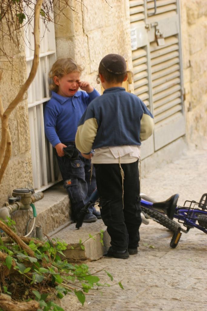 Quarrel and tears. Jerusalem, Israel.
