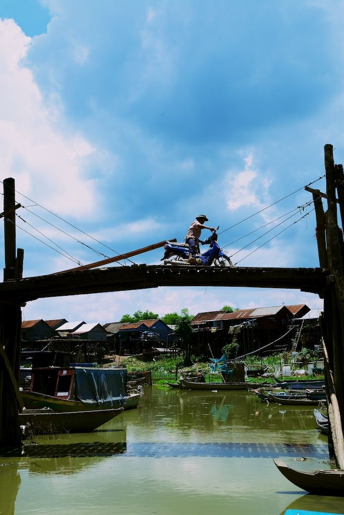 A fishing village's neck-breaking bridge. Cambodia.
