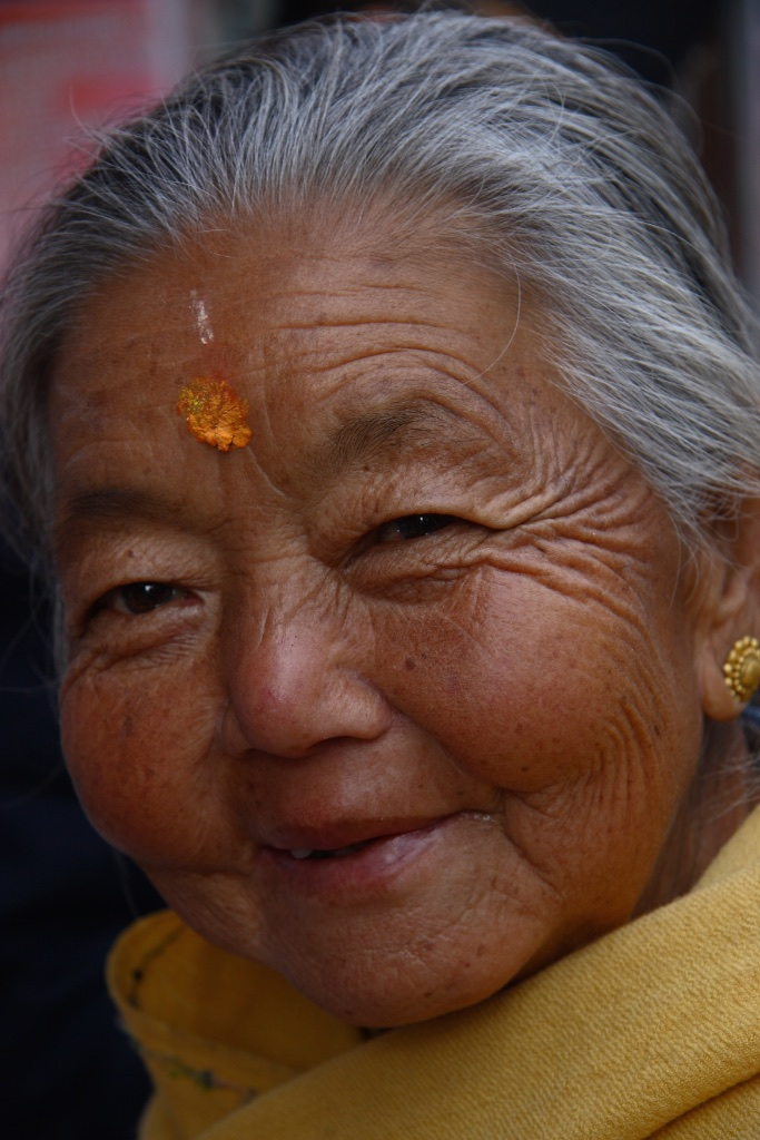 A glint in her eyes and a smile on her lips. Darjeeling, India.