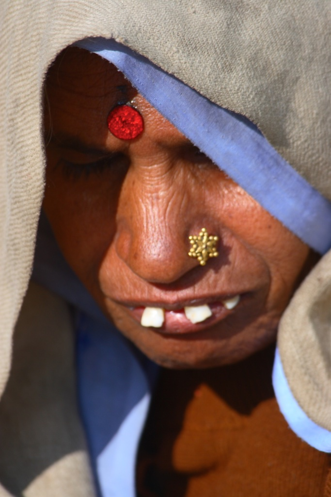 The blue ribbon gold star lady. India.