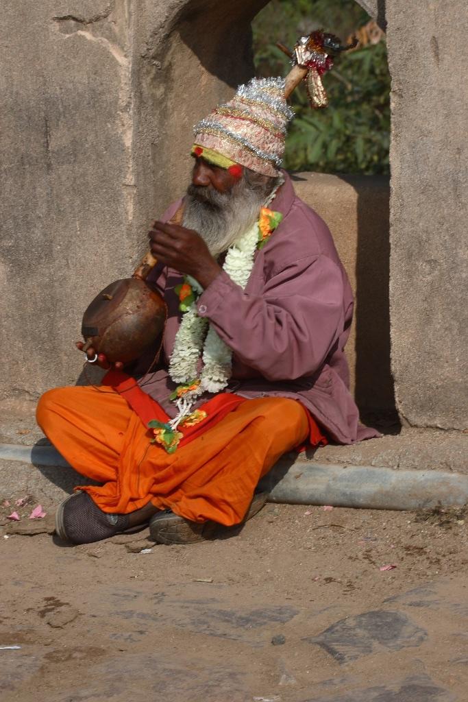 Indian street musician in sadhu garb.