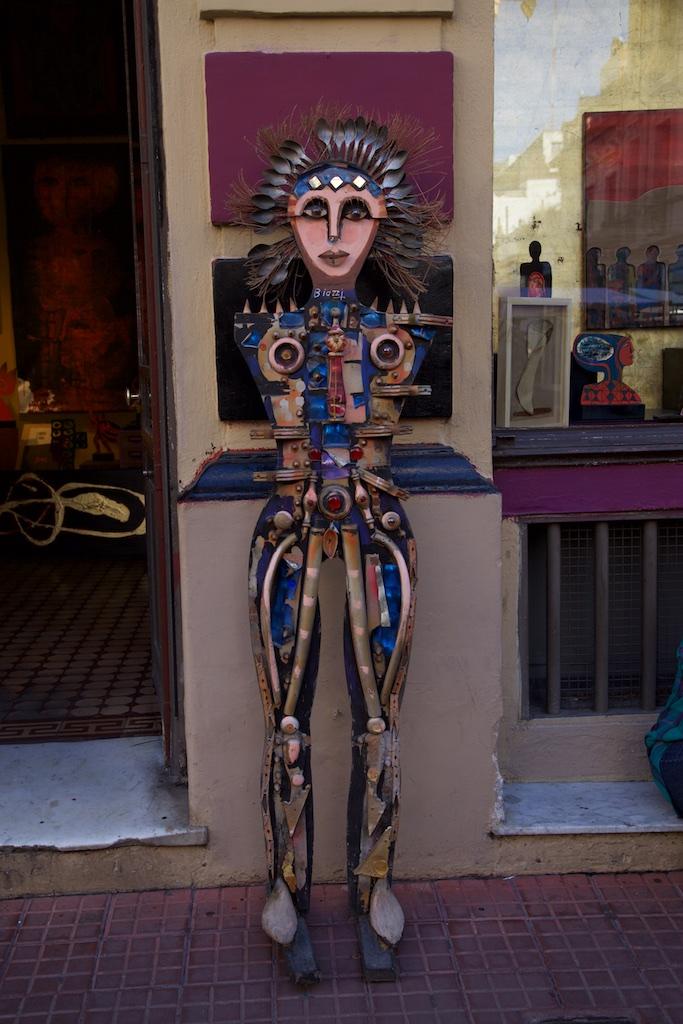 Well-sculpted bar waitress.