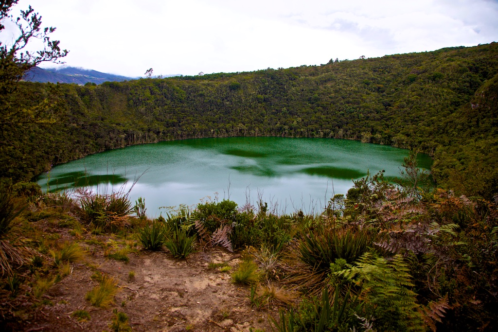 The perfectly round crater Guatavita, Colombia, where the legend of El Dorado was created
