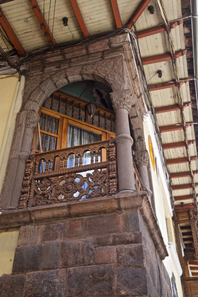 Window to a balcony, Cusco, Peru