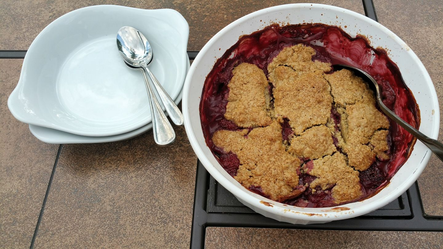 O.A.T .  M aine  S trawberry  C obbler  Preheat oven to 375 degrees with racks in middle and bottom.  Stir together 2 C. berries, 1/4 C. sugar, 1 T. cornstarch, 1 T. lemon juice. Transfer to a 2 1/2-quart baking dish.  Cut in 3 T. cold butter, until the largest pieces are the size of small peas, into 1 C. O.A.T. Blend. Add 6 T. Milk, and use a fork to incorporate, stirring until a soft sticky dough forms. Dollop dough over filling, dividing evenly. Sprinkle with sugar.  Bake until biscuits are golden brown and filling is bubbling in the center, about 45 Minutes. Cool at least 1 hour before serving. Serve warm or room temperature with a scoop of ice cream or Greek Yogurt.