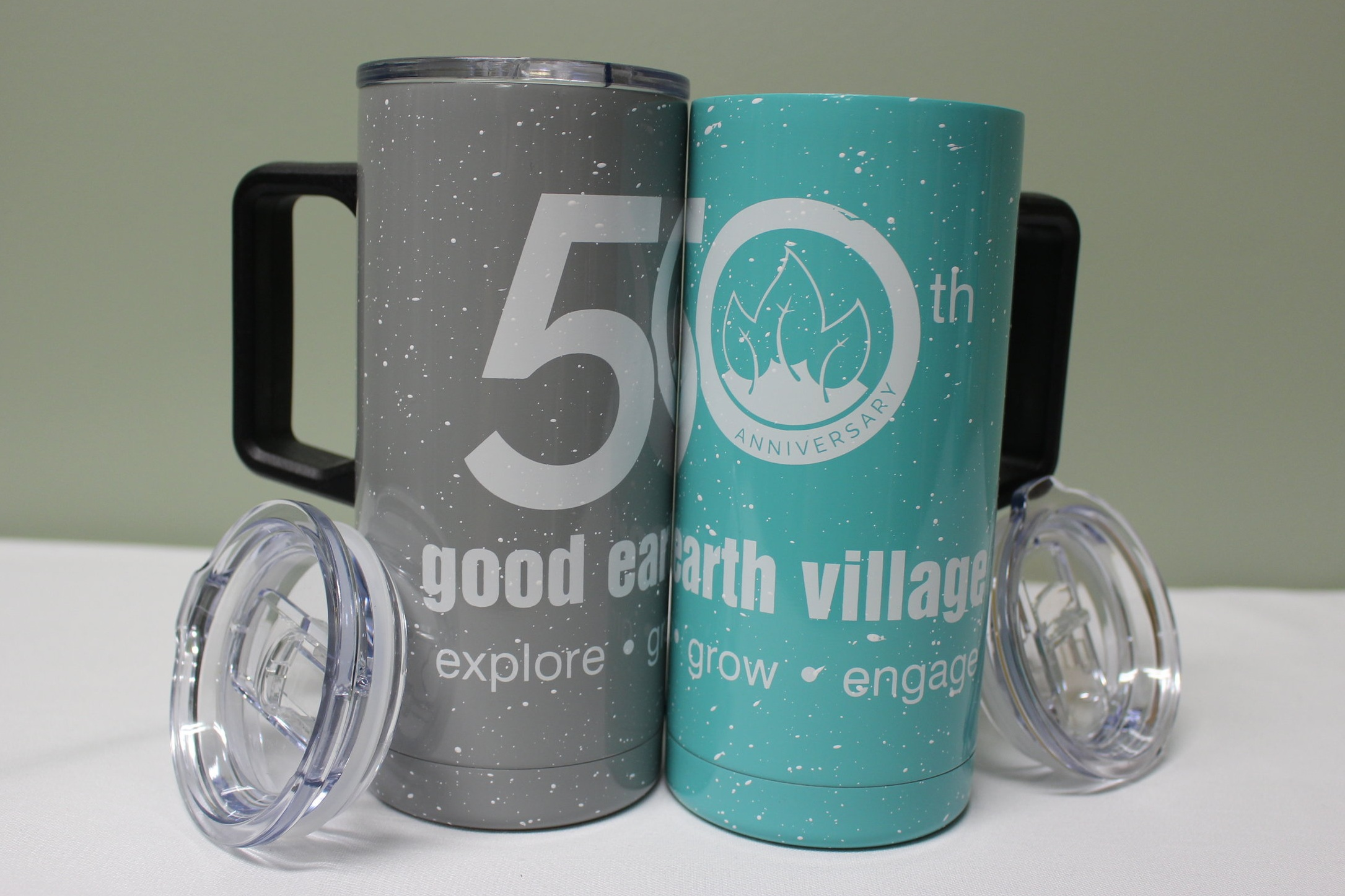 Item:  50th Anniversary 18oz Travel Mug  Colors:  Gray and Sea-foam  Price:  $25